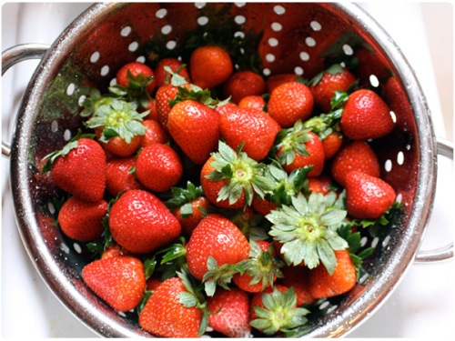 strawberries in colander