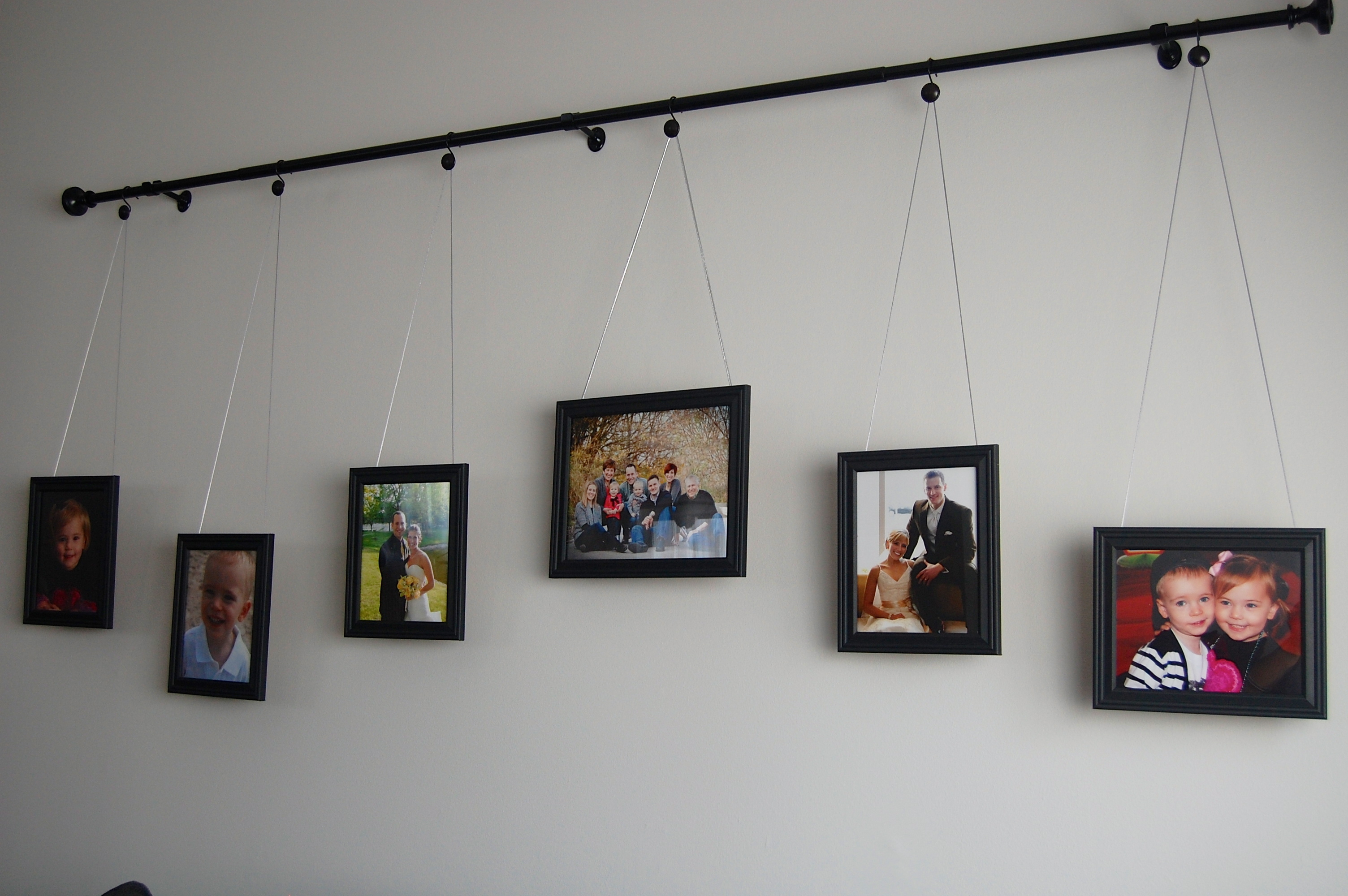 Diy curtain rod gallery wall for Curtain display ideas